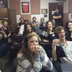 Image of students sharing a laugh during a voice-over demonstration.