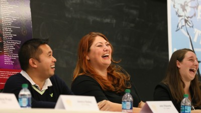 Image of alumni panelists sharing a laugh at the 2014 Trojan Family Weekend.