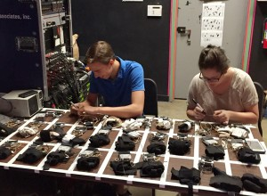 Photo: Sound PA Stephen Jensen, left, and A2 Emma Bramble prepare mics backstage prior to the tech.