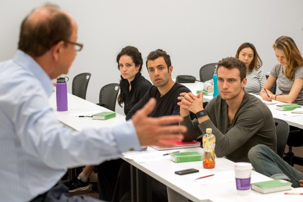 MFA actors at the USC School of Dramatic Arts listen to President C. L. Max Nikias.