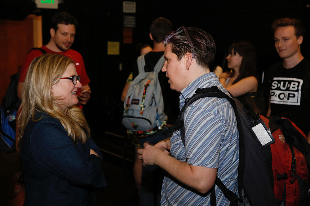 Nancy Cartwright talking to a student