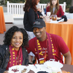 Parents at breakfast table in USC spirit wear