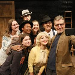 Associate Professor of Theatre Practice John DeMita with students