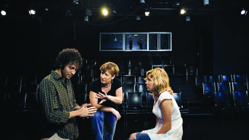 Photograph of Charlotte Cornwell coaching students in the Massman Theatre.