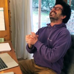 Image of Zach Steel laughing at desk