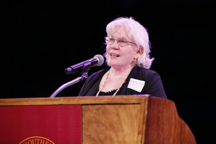 Tina Haatainen-Jones speaking at podium