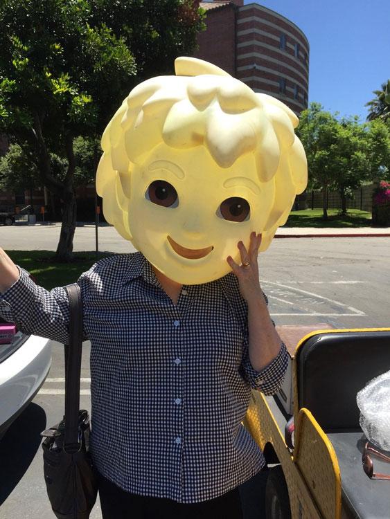 Tina Haatainen-Jones wearing a costume head on campus